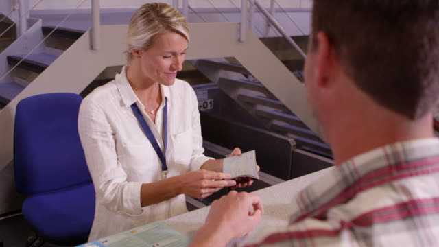 Man Going On Vacation Checking In At Airport Shot On R3D video