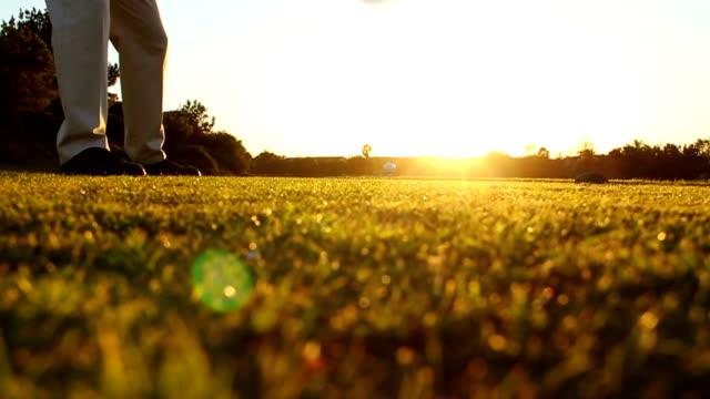 Man Golfing Hits Tee Shot Into Sunset video