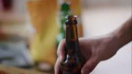 Man grabbing beer bottle video