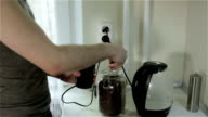 A man grinding coffee beans. video