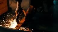 Man grindstones in workshop 4K video