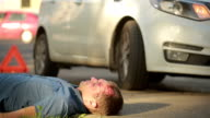 man had a car accident. head smashed. pedestrian injured in road accidents video