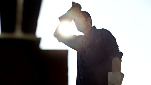 Man hammering outside video