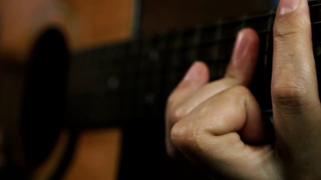man hand playing on acoustic guitar video
