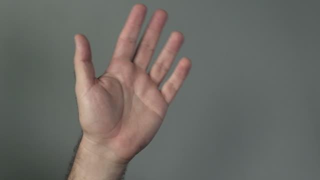 Man hand wave hello video