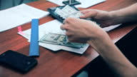 Man hands counting money US dollars on his workplace in office video