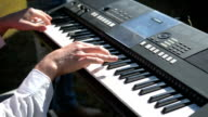 Man hands playing on the keyboard video