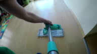 Man hands put wet mop on broom and wash dust from wood floor. video