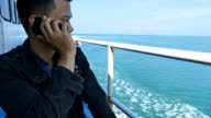 man happy with electronic device in holiday on the boat video