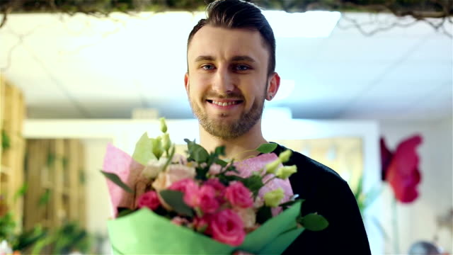 A man have bought a beautiful bouquet in a flower shop. video