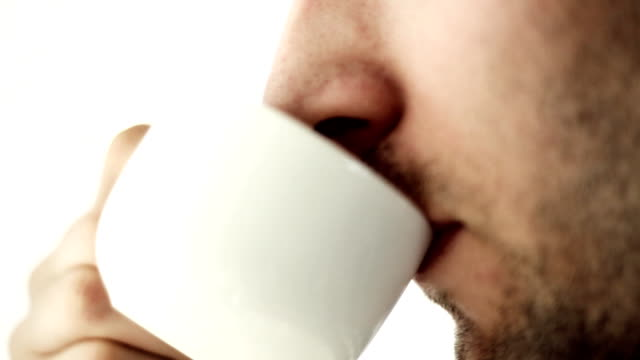 Man having a cup of coffe, close up video
