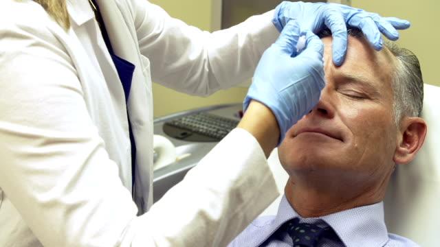 Man Having Botox Treatment At Beauty Clinic video