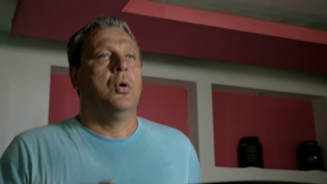 Man having cardio training on treadmill video