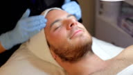 Man Having Dermo Abrasion Cosmetic Treatment At Spa video