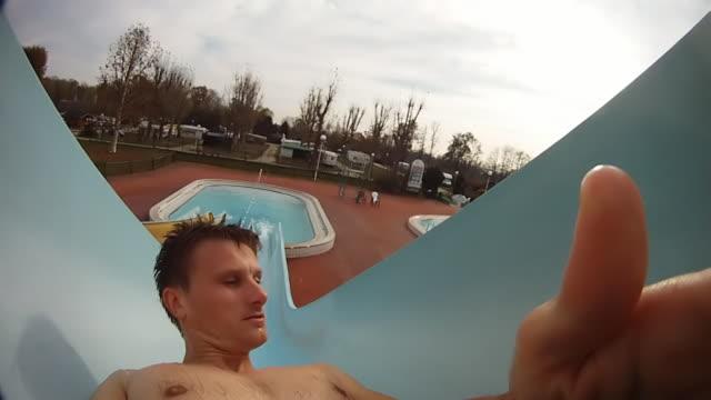 HD SLOW MOTION: Man Having Fun On A Waterslide video