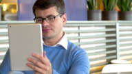 Man Having Video-Call with Tablet video