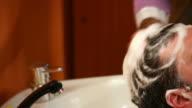 Man head in hair salon. video