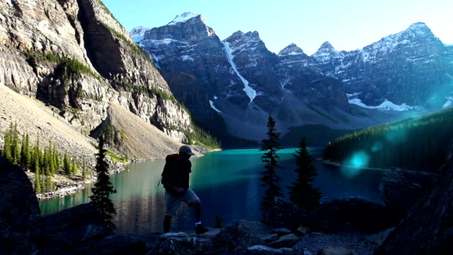 Man hikes in a rugged mountain landscape video