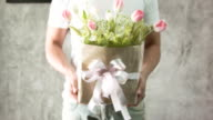 Man holding a bouquet tulips. video