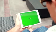 Man Holding Blank Tablet PC With Green Screen video