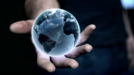 Man holding earth model in his hand. Global communications metaphor video