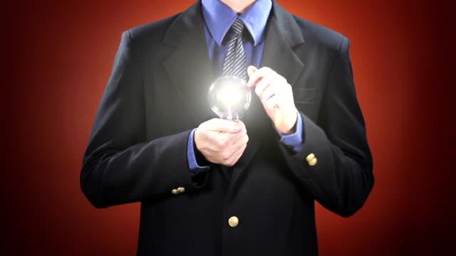 Man Holding Light Bulb video
