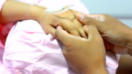 man holding patients hand video