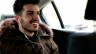 Man in a car with earphones video