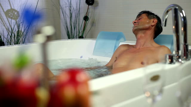 HD STOCK: Man in a jacuzzi video