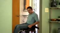 Man in a wheelchair entering his home video