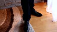 Man in black shoes walking video