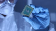 Man in clean room holds up computer cpu microchip video