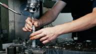 Man in factory measure  hole in steel with vernier caliper. video