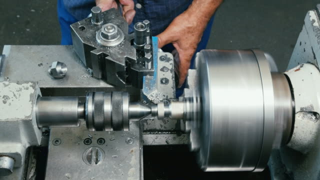Man in factory work at Milling Machines video
