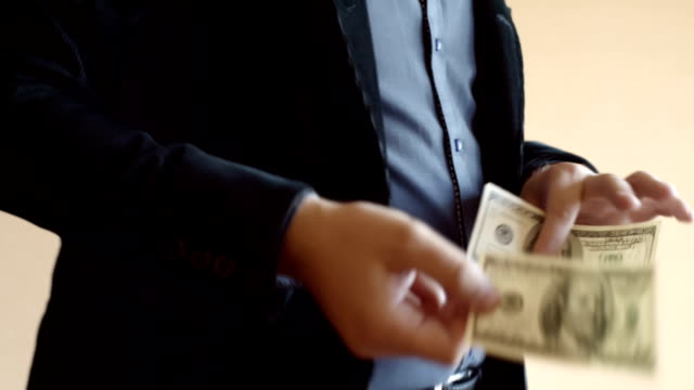 Man In Fashionable Suit Collects One Hundred Dollar Bills video