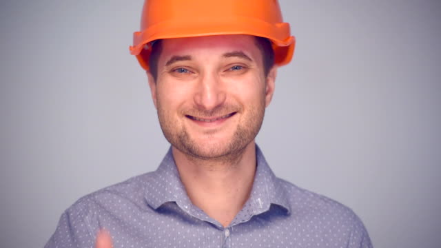 Man in helmet gesturing thumb up sign video