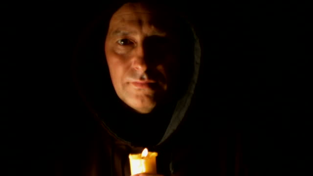 Man in hood with candle video
