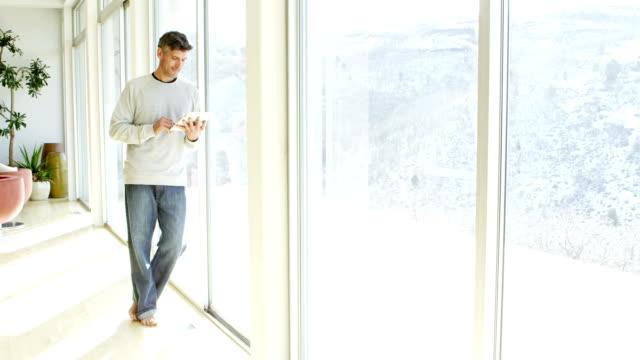 Man in modern home video