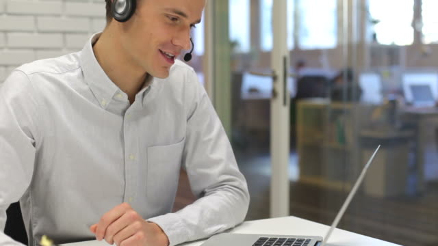 Man in office on video conference, Skype video