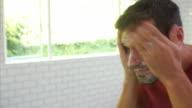 Man In Pajamas Washing Face In Bathroom video