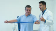 Man in physiotherapy video