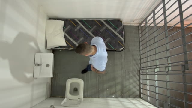 4K AERIAL: Man in Prison cell pacing the floor video
