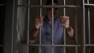 4K: Man in prison cell shaking the bars video