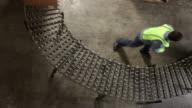 Man in shipping warehouse moves boxes along conveyor video