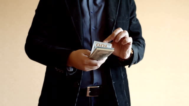 Man In Suit And One Hundreed Dollar Bills In His Hand video