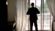 Man in suit near window. video