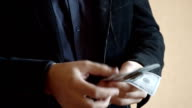 Man In Suit Takes Money From His Pocket And Counting One Hundred-Dollar Bills video