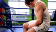 A man in the Boxing ring listening to music video