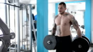 Man in the gym. Slow motion video