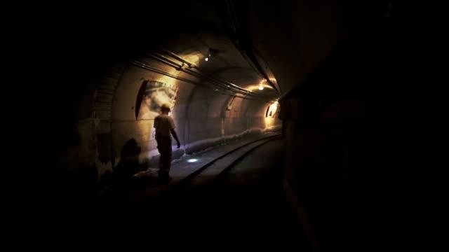 Man in tunnel underground of a mine video